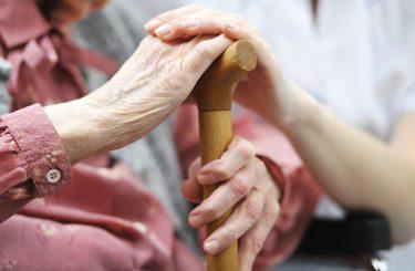 Elderly Woman Hands Cane