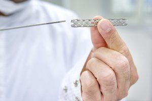 in cardiac patients where a stent isn't necessary or effective, does implanting the device constitute medical malpractice?