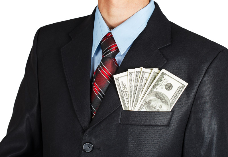 Dollars in businessman suit pocket