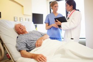 Patient in Hospital Bed Staff Discusssion